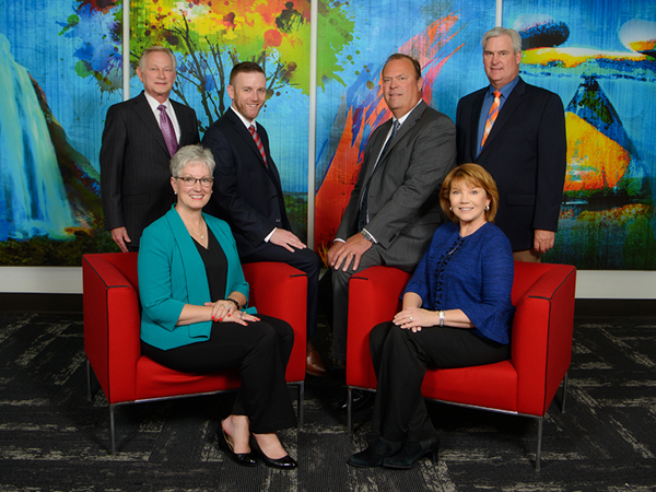 Financial Advisors of the Sioux City Stifel office in front of artwork.